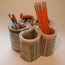 Here's an awesome recycling idea for Earth Day or Father's Day. Recycle an  old phone book into a pen holder to put on Dad's desk. T.