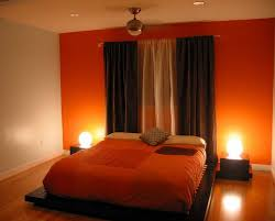 Orange accent wall, others a light to medium gray. black or black and gray  curtains.