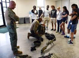 hillsborough deputies help teens learn job skills com swat team members john masson left and jimmy cook show the teenagers some of