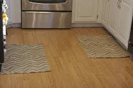 light colors on kitchen rugs create spacious illusion and help open the room while dark colors give opposite effect but cozier