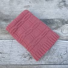 hand knitted raspberry pink pure wool baby rug blanket with cable design