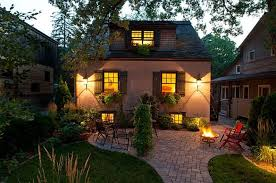 outdoor garden lighting ideas. Pretty Outdoor Lighting Ideas For Wonderful Garden With Paved Patio And Red Chairs Traditional Home Plan