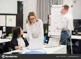 Two Beautiful Office Workers Having Conversation While Man