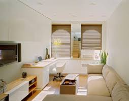 office space saving ideas. Sectional Couches In Beige Covers With Added Space Saving Cabinetry And Home Office Table Set As Open Small Apartment Decors Views Ideas