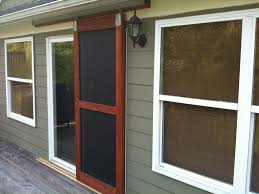 built a sliding screen door doubled with a black frame