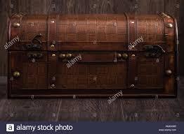 Beautiful decorative trunk treasure chest storage box on brown background