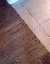installing hardwood against tile