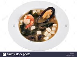 Asian seafood soup with cubes of cheese ...