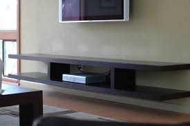 Black Wooden Floating Shelves Under Grey Tv On Grey Wall. Nice Picture Ideas