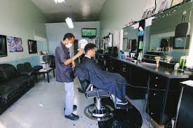 photo essay meet k fly one of north oakland s n barbers samuel ghile 27 has come to k fly s barber shop from san francisco