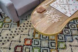 game room with colorful aztec print rug gold and metal table and the