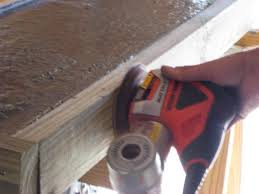 run an orbital sander without sandpaper along the sides of the frame to