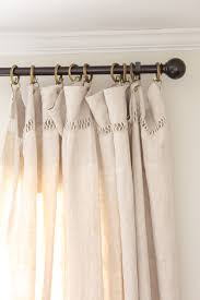 love the way french linen sheets hang as curtains black rod gold rings small detail on top of sheets