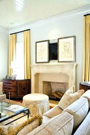 cabinet to hide tv wall mounted cabinet over fireplace how to hide above the fireplace framed paintings white cabinet hide tv