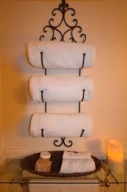 wine towel rack. Wine Rack Used As A Towel Holder. Very Chic!