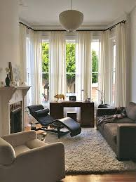 living room with bay window window treatment ideas for bay windows vintage desk custom upholstery couch