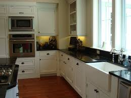farmhouse kitchen design built in stoves oven brown varnished wood cabinet white wooden cabinets two wooden