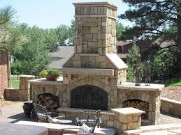 outdoor fireplace design ideas. outdoor fireplace design, pyramid brown stone classic arrangement three seat wood vases flowers garden design ideas