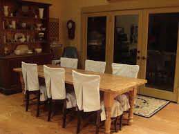 slip cover for chair in dining room with long rectangular table and big hutch