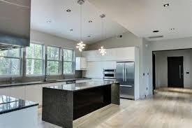 contemporary black cabinets white countertops dark gray