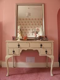 furniture beige wooden dressing table with legs and drawers on pink rug added by rectangle