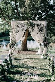 greenery and white garden wedding arch and aisle decoration ideas