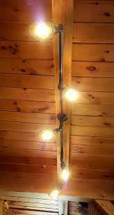 rustic track lighting commercial by farmsteadironworks