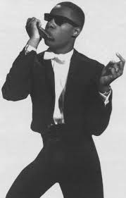 Image result for image of stevie wonder playing the harmonica