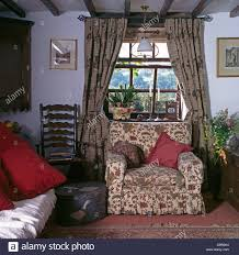 Patterned Curtains For Living Room Patterned Drapes On Window Above Floral Armchair In Cottage Living