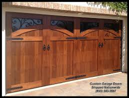 garage doors. Mediterranean Garage Door Designs In Solid Wood. This Is Gorgeously Decorated With Dummy Iron Doors