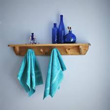 wooden bathroom wall shelf with hooks