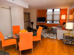 Orange And Brown Living Room Contemporary Living With A Rustic Flair Rachel James Hgtv