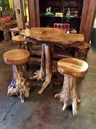 Balinese Teakwood root pub table set. includes four stools and table.  $1995.00 SOLD OUT