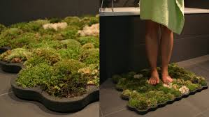 Moss Rug: Bathroom rug composed of forest moss, watered by the drops  streaming along the legs and the environment's humidity