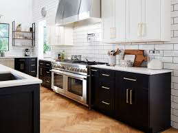 two toned cabinets help to break things up mcgee says the black cabinets on the bottom ground the space while the white cabinets on top draw your eye