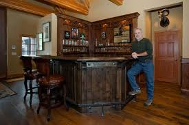 Captivating Amazing Design Of The Home Bar Designs With Black Wooden Materials Added  With Brown Wooden Floor