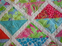 Down To Sew: Lilly Pulitzer baby quilt and 2 more baby quilts & ... quilt with Lilly Pulitzer fabrics. I custom quilted a geometric design  in each triangle and pebbles in the white sashing. Adamdwight.com