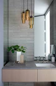gold pendant modern bathroom lighting above small cube flower vase on wall mounted bathroom vanity amazing contemporary bathroom vanity
