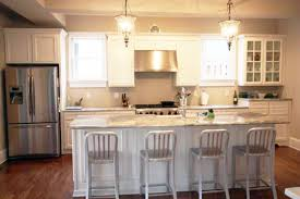 off white kitchen cabinets with granite countertop