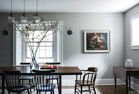 darryl carter designed an origami inspired glass and steel light diffuser that is the centerpiece of this modern dining room the chandelier serves as a