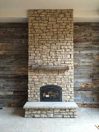 reclaimed wood wall barn grey fireplace w steel trim porter architecture fireplaces with surround pallet corner stone