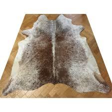 large cream brown cow hide rug