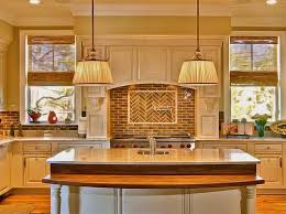 wall paint colors for white kitchen cabinets with glass windows and pendant lamps