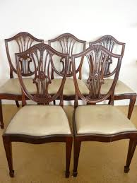hepplewhite shield dining chairs set: lot  a set of five older reproduction hepplewhite mahogany shield back dining chairs with
