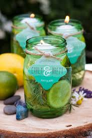 floating citronella candles with personalized favor tags from evermine evermine com