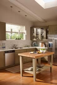 spacious kitchen wooden countertop glass cabinet backyard