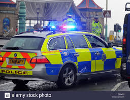 Police Car Lights Uk The Blue Light On Top Of A A Police Car Flashing At The