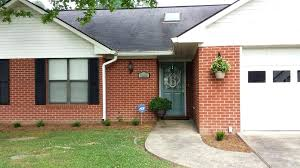 shutters on brick house red brick house with black shutters and front door painted with plus
