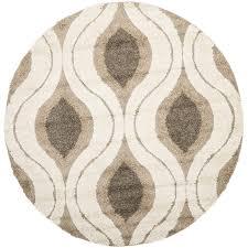 cream and smoke round area rug