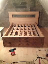DIY bed frame, all made from recycled materials - doors, pallets ...